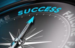 Success text on a compass