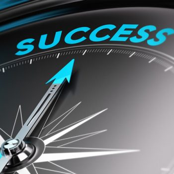 Success text on a compass